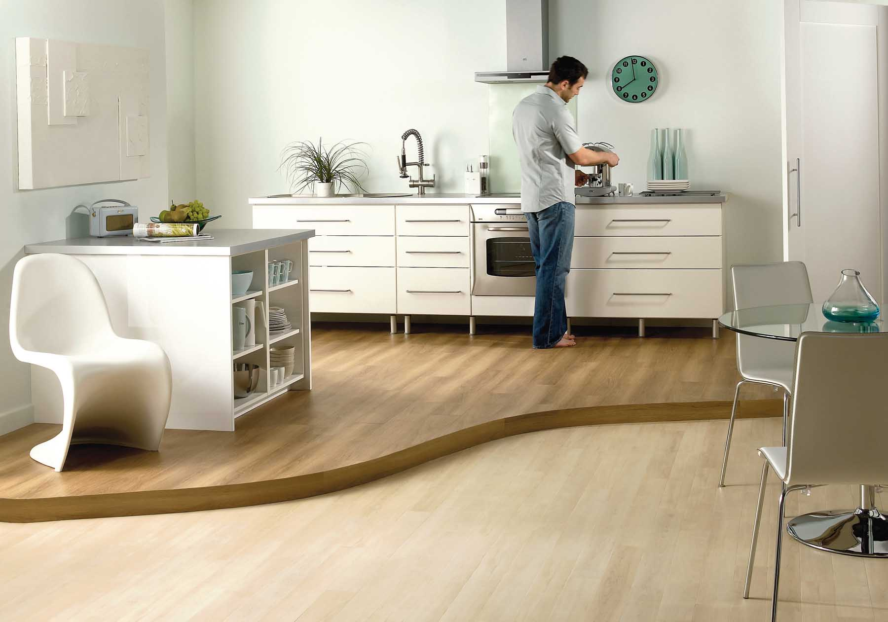 Laminate Flooring In A Kitchen laminate flooring in a kitchen amazing kitchen designs laminate flooring in the kitchen laminate floor Laminate Flooring Kitchen Delivered By Inspire Flooring Aberdeen Where A Man Is Preparing A Cup Of